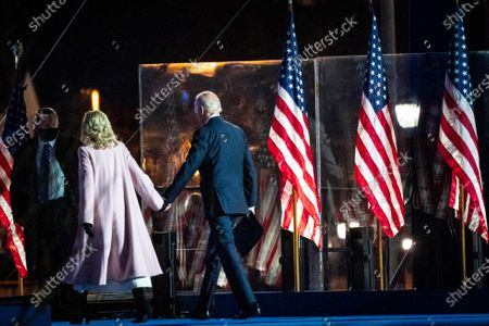 Democratic Candidate and former Vice President Joe Biden (R) and his wife Dr. Jill Biden (L) depart after greeting attendees during his Election Night event at the Chase Center in Wilmington, Delaware, USA, early 04 November 2020. The 2020 Presidential Election result remains undetermined as poll workers continue to count ballots in several key battleground states.