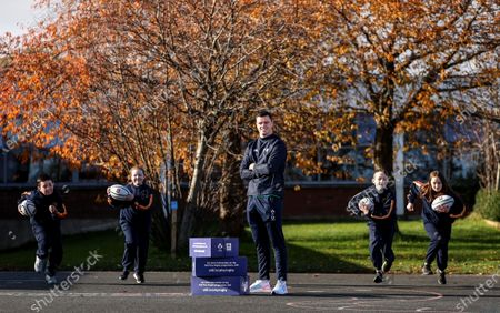 Stock Image of Aldi has announced today the signing of Ireland rugby international James Ryan as an ambassador for the Aldi Play Rugby Programme. James joins Paul O'Connell on the team, with Paul having worked with Aldi since Aldi's partnership of the programme commenced in 2016. James is pictured here with Sean Crowley, Grace Mullen, Dylan Sweeney and Ava Hickey, 5th Class, Scoil Maelruain, Old Bawn, Tallaght, Dublin. James kicked off his role with a socially-distant delivery of Aldi Play Rugby training equipment to Scoil Maelruain, Old Bawn, Tallaght who will be among the primary schools participating in the programme with online support from the IRFU community rugby officers. Today's announcement underpins Aldi's ongoing commitment to and support of the sport of rugby as the Official Fresh Food partner to the IRFU. For more information see www.aldi.ie/playrugby.