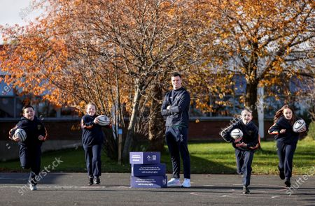Aldi has announced today the signing of Ireland rugby international James Ryan as an ambassador for the Aldi Play Rugby Programme. James joins Paul O'Connell on the team, with Paul having worked with Aldi since Aldi's partnership of the programme commenced in 2016. James is pictured here with Sean Crowley, Grace Mullen, Dylan Sweeney and Ava Hickey, 5th Class, Scoil Maelruain, Old Bawn, Tallaght, Dublin. James kicked off his role with a socially-distant delivery of Aldi Play Rugby training equipment to Scoil Maelruain, Old Bawn, Tallaght who will be among the primary schools participating in the programme with online support from the IRFU community rugby officers. Today's announcement underpins Aldi's ongoing commitment to and support of the sport of rugby as the Official Fresh Food partner to the IRFU. For more information see www.aldi.ie/playrugby.