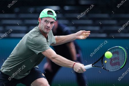 Tommy Paul of the U.S. returns the ball to Switzerland's Stan Wawrinka during the second round of the Paris Masters tennis tournament at the Bercy Arena in Paris
