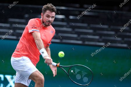 Switzerland's Stan Wawrinka returns the ball to Tommy Paul of the U.S. during the second round of the Paris Masters tennis tournament at the Bercy Arena in Paris