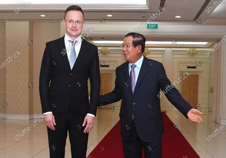 Cambodian Prime Minister Hun Sen (R) greets Hungary's  Minister of Foreign Affairs and Trade Peter Szijjarto (L), during a meeting at the Peace Palace in Phnom Penh, Cambodia, 03 November 2020 (issued 04 November 2020). According to media reports, Peter Szijjarto tested positive for the covid-19 in Thailand after visiting Cambodia.