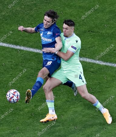 Yuri Zhirkov (L) of Zenit in action against Patric of Lazio during the UEFA Champions League group F soccer match between FC Zenit St. Petersburg and SS Lazio in St. Petersburg, Russia, 04 November 2020.