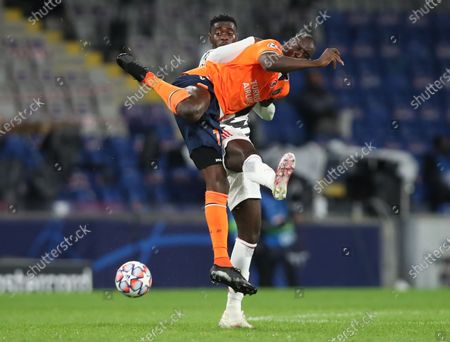 Demba Ba (front) of Basaksehir in action against Axel Tuanzebe (back) of Manchester United during the UEFA Champions League group H soccer match between Istanbul Basaksehir and Manchester United in Istanbul, Turkey, 04 November 2020.
