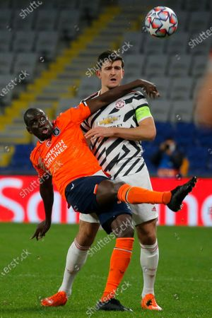 Basaksehir's Demba Ba, left, fights for the ball with Manchester United's Harry Maguire during the Champions League group H soccer match between Istanbul Basaksehir and Manchester United at the Fatih Terim stadium in Istanbul