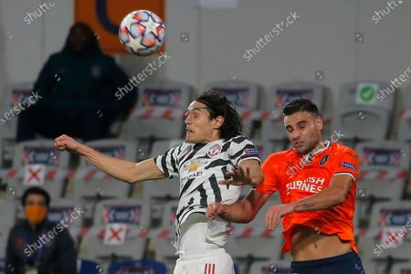 Stock Photo of Manchester United's Edinson Cavani, left, jumps for the ball with Basaksehir's Aziz Behich during the Champions League group H soccer match between Istanbul Basaksehir and Manchester United at the Fatih Terim stadium in Istanbul