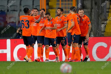 Istanbul Basaksehir players celebrate after Basaksehir's Demba Ba scores his side's opening goal during the Champions League group H soccer match between Istanbul Basaksehir and Manchester United at the Fatih Terim stadium in Istanbul