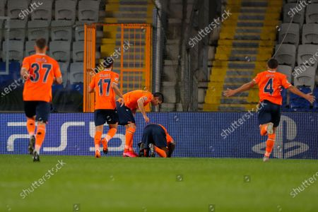 Basaksehir's Demba Ba, second right, celebrates after scoring his side's opening goal during the Champions League group H soccer match between Istanbul Basaksehir and Manchester United at the Fatih Terim stadium in Istanbul