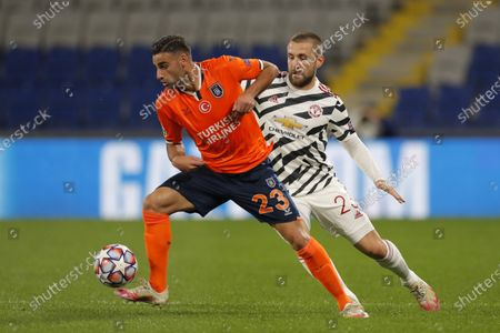 Stock Picture of Basaksehir's Aziz Behich, left, is challenged by Manchester United's Luke Shaw during the Champions League group H soccer match between Istanbul Basaksehir and Manchester United at the Fatih Terim stadium in Istanbul