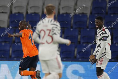 Basaksehir's Demba Ba, left, celebrates after scoring his side's opening goal during the Champions League group H soccer match between Istanbul Basaksehir and Manchester United at the Fatih Terim stadium in Istanbul