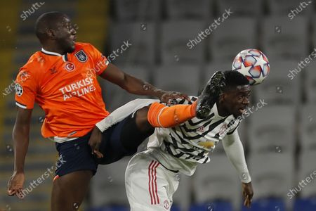 Basaksehir's Demba Ba, left, fights for the ball with Manchester United's Axel Tuanzebe during the Champions League group H soccer match between Istanbul Basaksehir and Manchester United at the Fatih Terim stadium in Istanbul