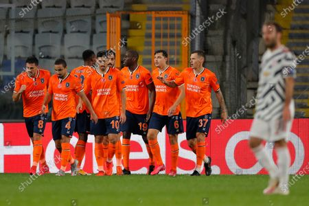 Basaksehir's Demba Ba, third right, celebrates after scoring his side's opening goal during the Champions League group H soccer match between Istanbul Basaksehir and Manchester United at the Fatih Terim stadium in Istanbul