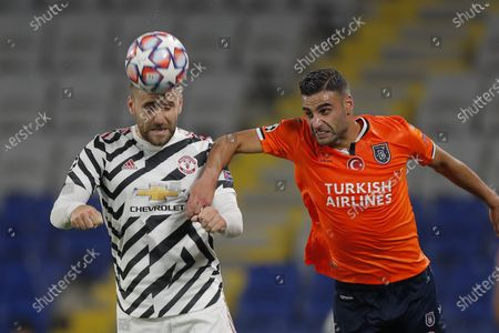 Manchester United's Luke Shaw, left, heads the ball past Basaksehir's Aziz Behich during the Champions League group H soccer match between Istanbul Basaksehir and Manchester United at the Fatih Terim stadium in Istanbul