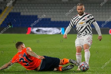 Basaksehir's Martin Skrtel, bottom, fights for the ball with Manchester United's Luke Shaw during the Champions League group H soccer match between Istanbul Basaksehir and Manchester United at the Fatih Terim stadium in Istanbul