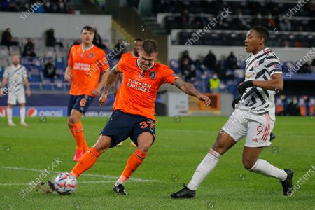 Stock Image of Basaksehir's Martin Skrtel, left, clears the ball in front Manchester United's Anthony Martial during the Champions League group H soccer match between Istanbul Basaksehir and Manchester United at the Fatih Terim stadium in Istanbul
