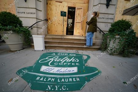 Stock Image of A boarded-up Ralph Lauren Store along Madison Avenue in New York City.