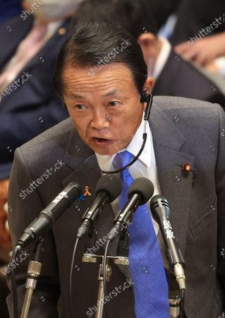 Japanese Finance Minister Taro Aso answers a question at Lower House's budget committee session at the National Diet in Tokyo on Wednesday, November 4, 2020.