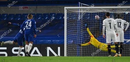 Chelsea's Timo Werner (back L) scores the 2-0 lead from the penalty spot against Rennes' goalkeeper Alfred Gomis (back C) during the UEFA Champions League group E soccer match between Chelsea FC and Stade Rennes in London, Britain, 04 November 2020.
