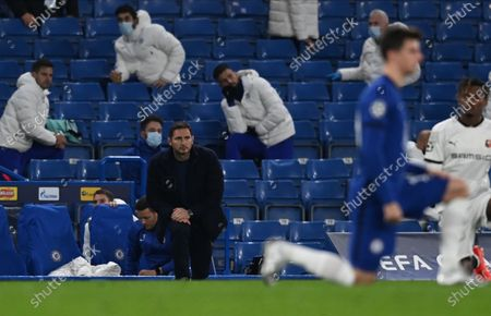 Stock Photo of Chelsea manager Frank Lampard (C) and players take a knee to support the Black Lives Matter movement before the UEFA Champions League group E soccer match between Chelsea FC and Stade Rennes in London, Britain, 04 November 2020.