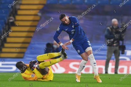 Rennes' goalkeeper Alfred Gomis saves as Chelsea's Hakim Ziyech challenges during a Group E Champions League soccer match between Chelsea and Rennes at Stamford Bridge stadium in London, England