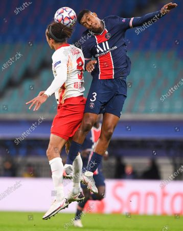 Yussuf Poulsen (L) of Leipzig in action against Presnel Kimpembe (R) of PSG during the UEFA Champions League group H soccer match between RB Leipzig and Paris Saint-Germain (PSG) in Leipzig, Germany, 04 November 2020.