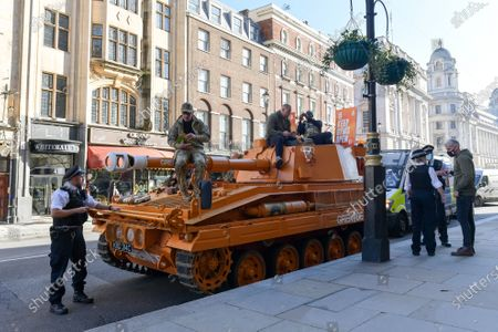 Stock Picture of Pictured: Police pull over James Haskell as he rides ontop of the Grenade® tank around Central London in protest of #KeepingGymsOpen during the second Coronavirus lockdown that starts tomorrow in England.  A bright orange tank driven by England rugby star James Haskell headed to Parliament Square today and caused a ruckus as it was stopped by police. The former international was joining performance nutrition brand Grenade in protesting gyms and leisure centres being classified as 'non-essential' under new lockdown regulations.  There were a reported 22 million visits to gyms after they reopened in July, with just 78 Covid cases being tracked to these locations. With England set to return to a nationwide lockdown from tomorrow (Thursday November 4) these leisure facilities will once again be forced to close, not being classed as 'essential'.