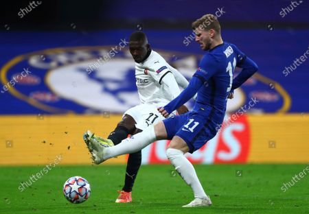 Chelsea's Timo Werner, right, and Rennes' M'Baye Niang challenge for the ball during the Champions League Group E soccer match between Chelsea and Rennes at Stamford Bridge, London, England