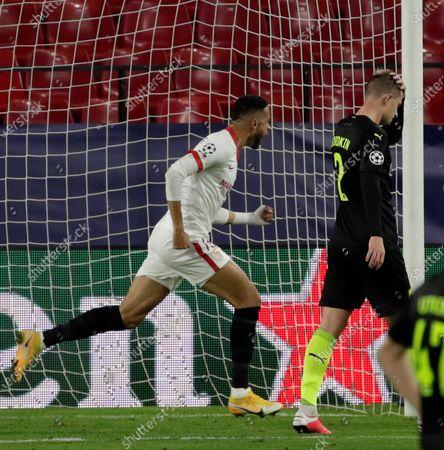 Sevilla's Youssef En-Nesyri (L) celebrates after scoring the 2-2 equalizer during the UEFA Champions League group E soccer match between Sevilla FC and FC Krasnodar at Sanchez Pizjuan Stadium in Seville, Spain, 04 November 2020.