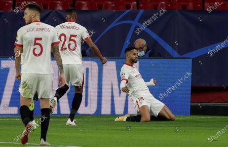 Sevilla's Youssef En-Nesyri (R) celebrates after scoring the 2-2 equalizer during the UEFA Champions League group E soccer match between Sevilla FC and FC Krasnodar at Sanchez Pizjuan Stadium in Seville, Spain, 04 November 2020.