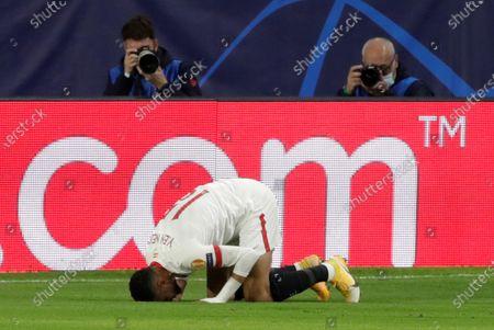 Sevilla's Youssef En-Nesyri reacts after scoring the 2-2 equalizer during the UEFA Champions League group E soccer match between Sevilla FC and FC Krasnodar at Sanchez Pizjuan Stadium in Seville, Spain, 04 November 2020.