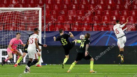 Sevilla's Youssef En-Nesyri, right, scores his side's third goal during the Champions League group E soccer match between Sevilla FC and FC Krasnodar, at the Ramon Sanchez Pizjuan stadium in Seville, Spain