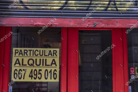 Stock Photo of A private owner announcing the availability of rental of his premises seen on Dels Canvis Nous street during the crisis.