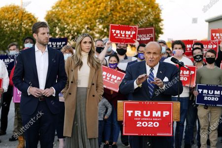Rudy Giuliani, a lawyer for President Donald Trump, speaks during a news conference on legal challenges to vote counting in Pennsylvania, in Philadelphia. At left are Eric Trump, son of President Trump, and his wife Lara Trump