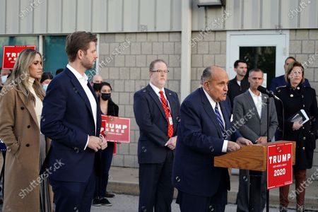 Rudy Giuliani, right, a lawyer for President Donald Trump, speaks during a news conference on legal challenges to vote counting in Pennsylvania, in Philadelphia. At left are Eric Trump, son of President Trump, and wife Lara Trump
