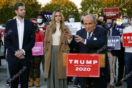 Rudy Giuliani, a lawyer for President Donald Trump, speaks during a news conference on legal challenges to vote counting in Pennsylvania, in Philadelphia. At left are Eric Trump, son of President Trump, and wife Lara Trump