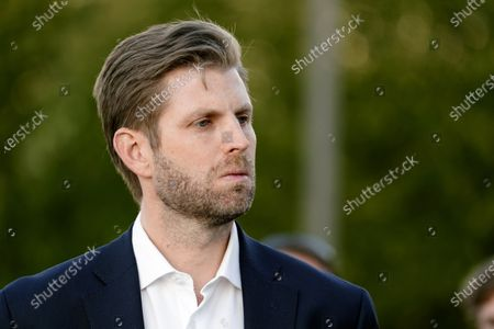 Eric Trump, son of President Donald Trump, listens to Rudy Giuliani, a lawyer for President Trump, speak during a news conference on legal challenges to vote counting in Pennsylvania, in Philadelphia