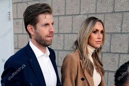 Eric Trump, left, son of President Donald Trump and wife Lara Trump depart after a news conference on legal challenges to vote counting in Pennsylvania, in Philadelphia