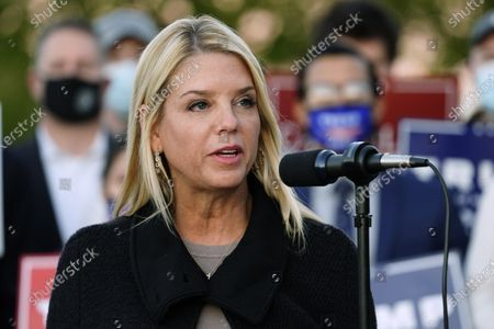Former Florida Attorney General Pam Bondi, center, speaks during a news conference on legal challenges to vote counting in Pennsylvania, in Philadelphia