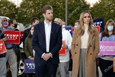 Eric Trump, son of President Trump, and wife Lara Trump listen as Rudy Giuliani, a lawyer for President Donald Trump, speaks off camera during a news conference on legal challenges to vote counting in Pennsylvania, in Philadelphia