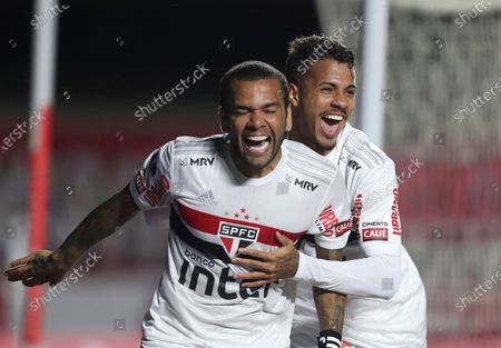 Daniel Alves of Brazil's Sao Paulo, left, celebrates with teammate Diego Costa after scoring his side's opening goal against Argentina's Lanus during a Copa Sudamericana soccer match in Sao Paulo, Brazil, Wednesday, Nov.4, 2020