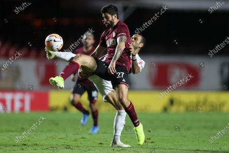Stock Photo of Dani Alves (behind) of Sao Paulo in action against Nicolas Orsini (front) of Lanus during a 2020 Copa Sudamericana soccer match between Sao Paulo and Lanus, at the Morumbi stadium, in Sao Paulo, Brazil, 04 November 2020.