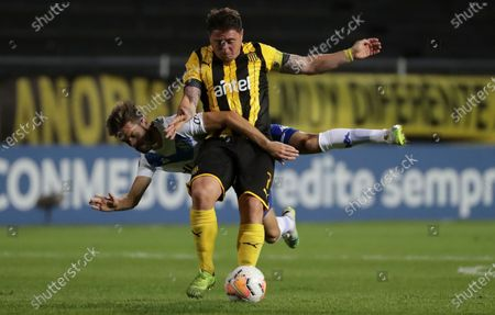 Cristian Rodriguez of Uruguay's Penarol, front, and Argentina's Velez Sarsfield's Agustin Bouzat battle for the ball during a Copa Sudamericana soccer match in Montevideo, Uruguay