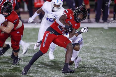 Northern Illinois Huskies running back Erin Collins (21) is tackled by Buffalo Bulls linebacker James Patterson (20)during the first half of an NCAA football game, in DeKalb, Ill