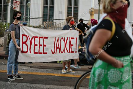 BLM supporters hold a banner that says Bye Jackie! at the BLM LA Jackie Lacey will go celebration in front of the Hall of Justice on Wednesday, Nov. 4, 2020 in Los Angeles, CA. (Jason Armond / Los Angeles Times)