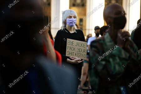 Hillary Jones of Long Beach holds a Bye Jackie! sign at the BLM LA Jackie Lacey will go celebration in front of the Hall of Justice on Wednesday, Nov. 4, 2020 in Los Angeles, CA. (Jason Armond / Los Angeles Times)