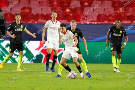 (L-R) Munir El Haddadi (Sevilla), Yury Gazinsky (Krasnodar) - Football / Soccer : UEFA Champions League Group stage Group E match between Sevilla FC 3-2 FC Krasnodar at the Estadio Ramon Sanchez-Pizjuan in Sevilla, Spain.