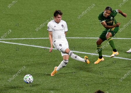 Stock Image of Portland Timbers forward Andy Polo, right, put shot past Colorado Rapids defender Sam Vines during the second half of an MLS soccer match in Portland, Ore