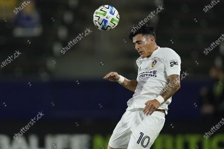 Stock Picture of Galaxy forward Cristian Pavon heads the ball during the first half of the team's MLS soccer match against the Seattle Sounders, in Carson, Calif