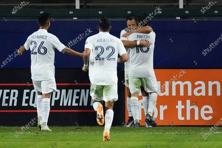 Galaxy forward Javier Hernandez, second from right, celebrates with midfielder Efrain Alvarez (26), defender Julian Araujo (22), and forward Cristian Pavon (10) after scoring a goal during the second half of the team's MLS soccer match against the Seattle Sounders, in Carson, Calif