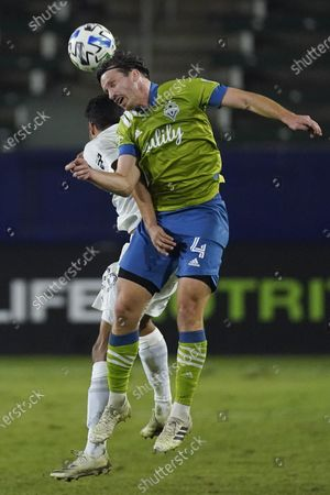 Galaxy forward Ethan Zubak, left, and Seattle Sounders midfielder Gustav Svensson head the ball during the second half of an MLS soccer match, in Carson, Calif